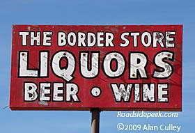 Roadside peek liquor store signage arizona
